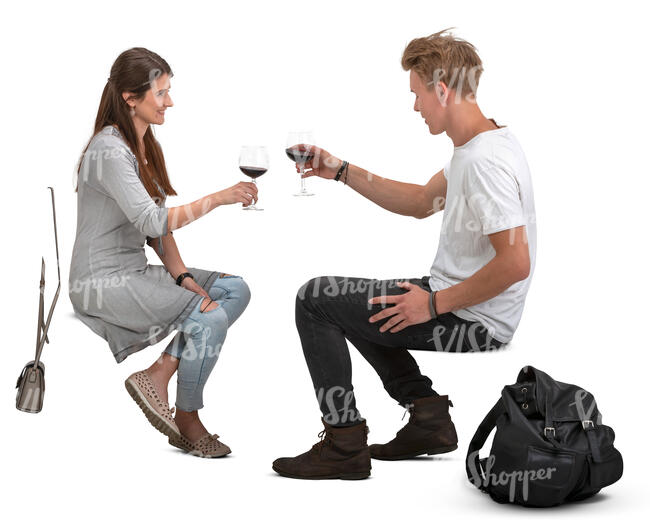 man and woman sitting and drinking wine