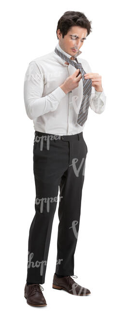 man standing and tying a tie