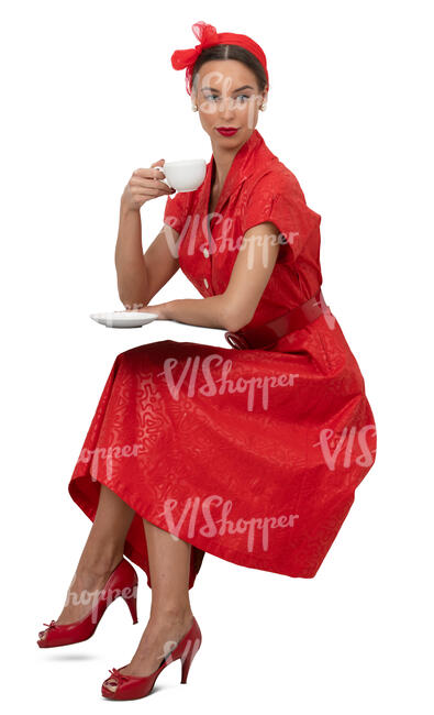 woman in a vintage red dress sitting and drinking coffee
