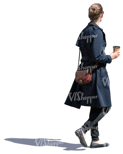 woman in a blue overcoat drinking coffee on the go