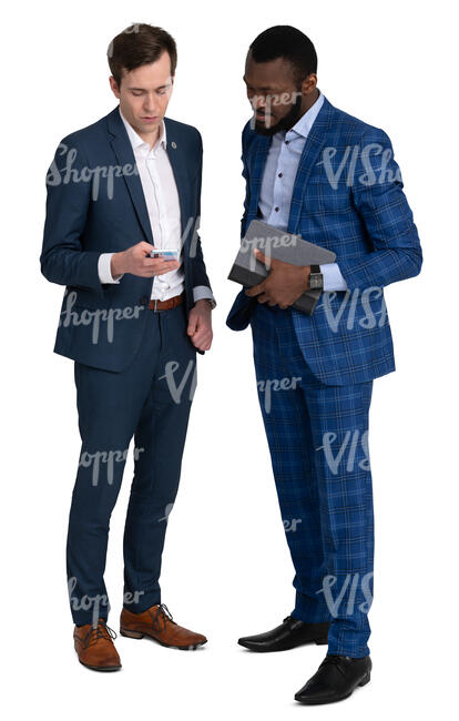 two men in suits standing and looking smth from a phone
