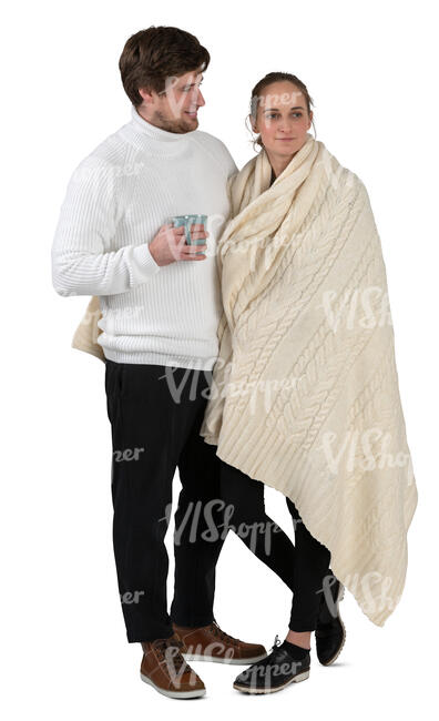 hygge couple standing in home and drinking coffee