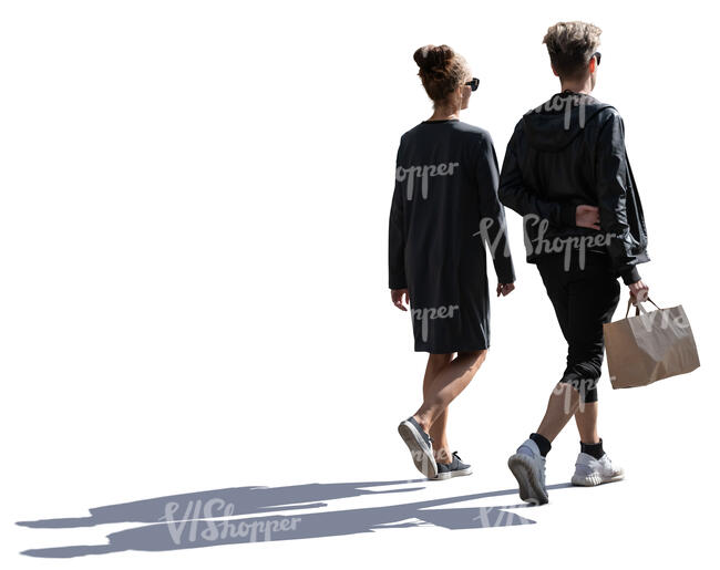 young backlit man and woman with a shopping bag