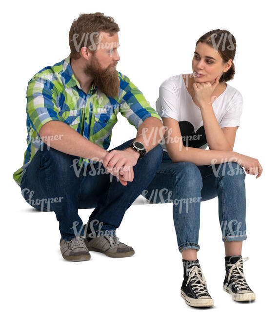 two people sitting on stairss and talking