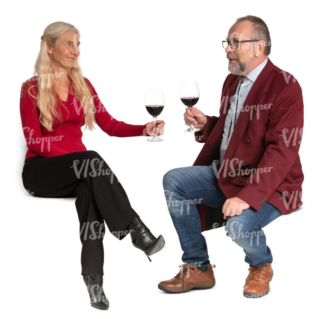 senior couple sitting in a cafe and drinking wine