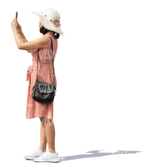 asian woman with a hat standing and taking a picture