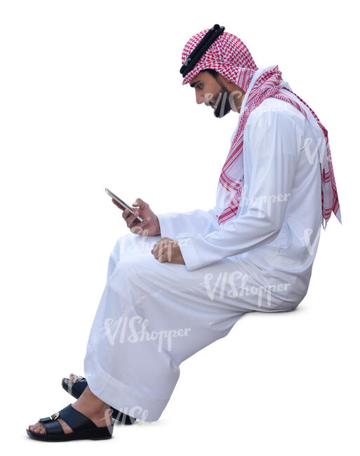 arab man in traditional clothing sitting and texting