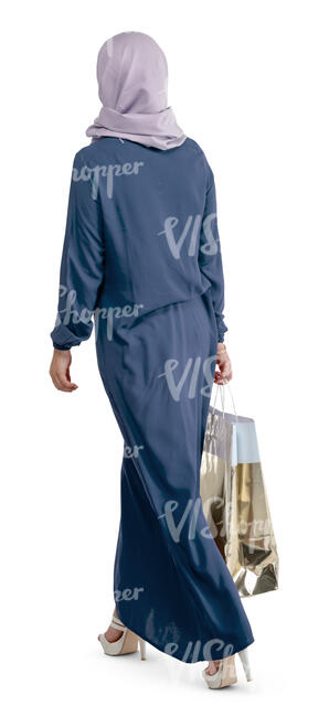 muslim woman with a shopping bag walking