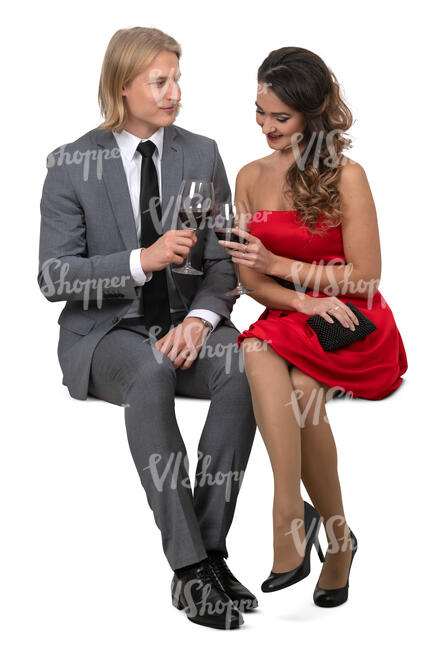 couple sitting in a restaurant and drinking wine