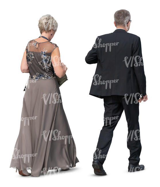 older couple in formal clothes walking