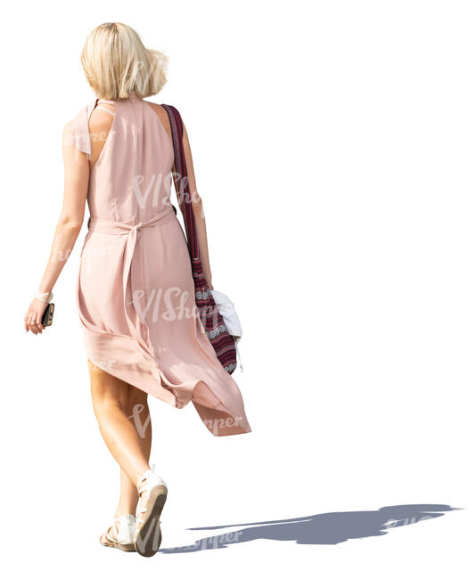 woman in a pale pink dress walking