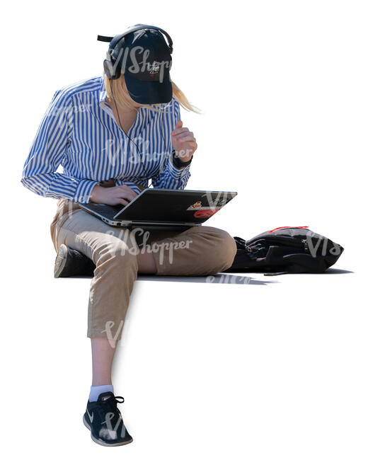woman with laptop and headphones sitting