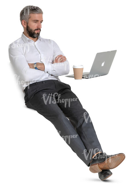 businessman sitting at a desk and drinking coffee