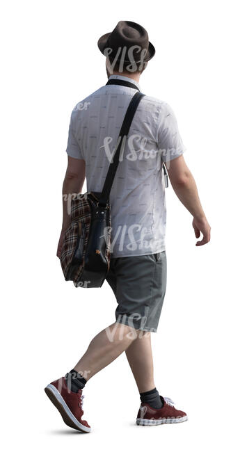 man with a hat walking on a summer day
