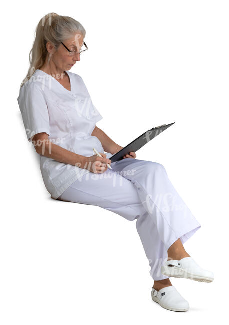 female nurse sitting and reading some papers