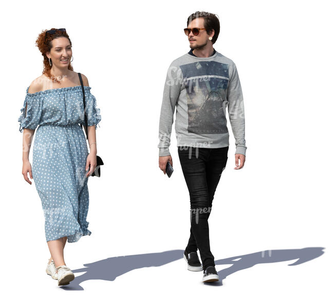 man and woman walking on a sunny day