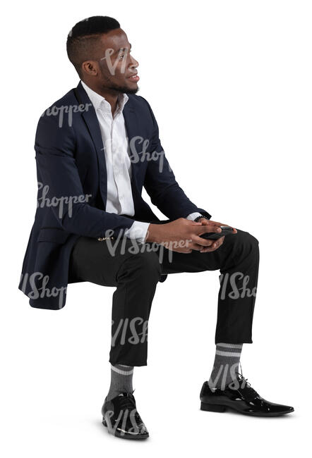 black man in a suit sitting on a chair