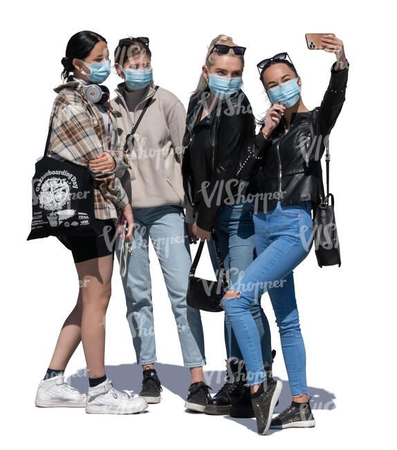 four girls with case masks standing and taking a selfie