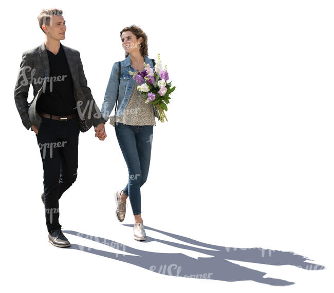 backlit couple walking hand in hand