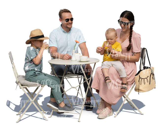 family with two kids sitting in a cafe on a summer day
