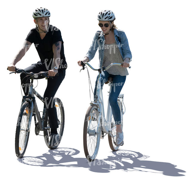 cut out backlit image of a man and woman riding a bike