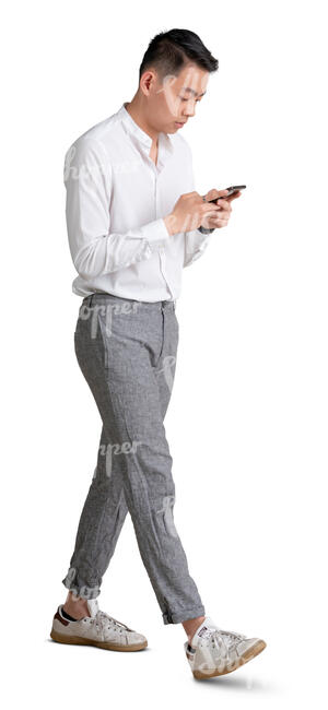 cut out young asian man walking with a phone in his hand