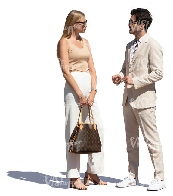 cut out man in a white suit standing and talking with a beautiful woman