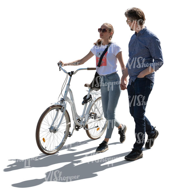 cut out backlit couple with a bicycle walking hand in hand