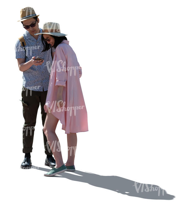 cut out backlit asian couple standing and looking at their smartphone