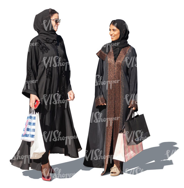 two cut out muslim woman with shopping bags standing anad talking