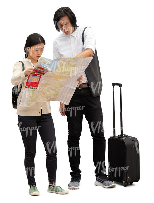 cut out asian tourists standing and looking at a city map