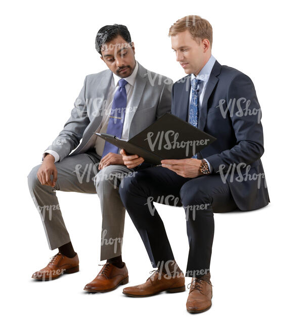 two cut out businessmen sitting and reading some papers
