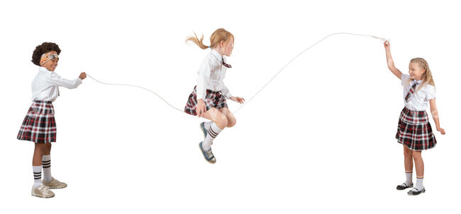 three cut out schoolgirls playing with jumping rope