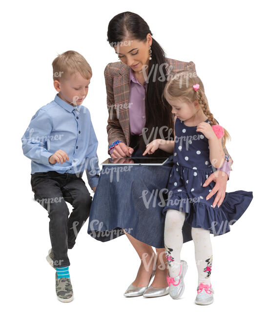 cut out woman with two kids sitting and watching smth from a tablet