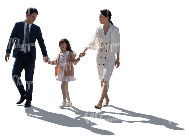 cut out backlit image of an asian family walking