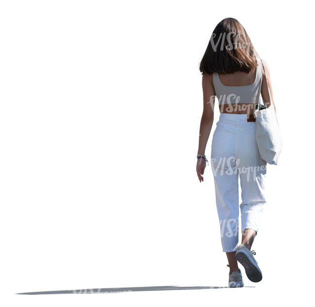 cut out young backlit woman walking