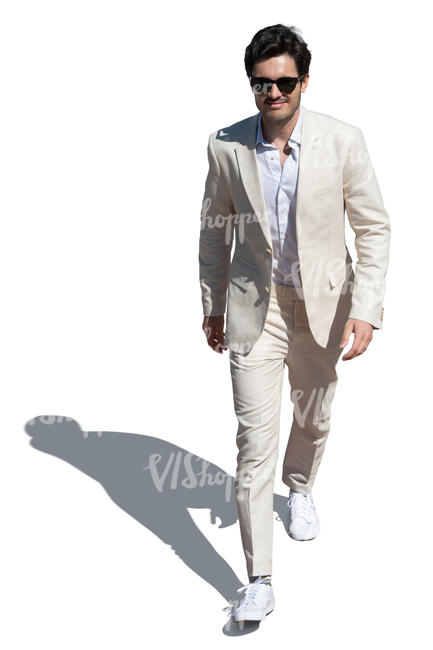 cut out man in a white suit walking seen from above