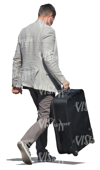 man in a suit carrying a suitcase