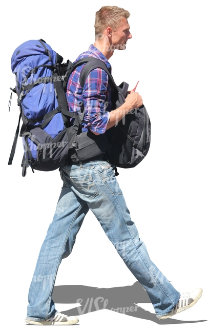 man carrying two bags walking
