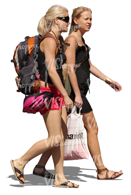 two young women with backpacks walking in summer
