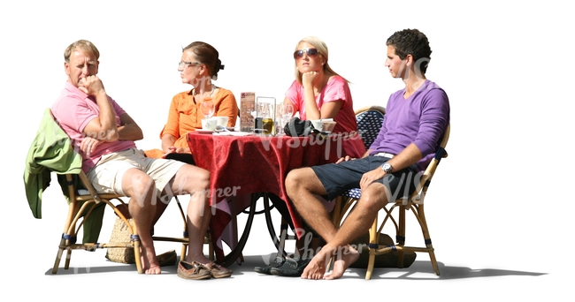 four people sitting in a street cafe