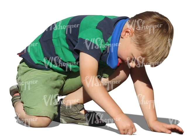 cut out boy playing on the ground