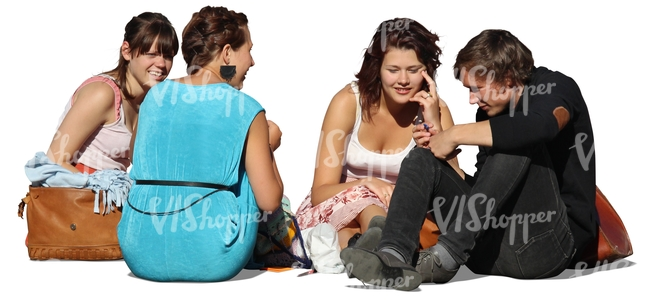 four people sitting on the ground