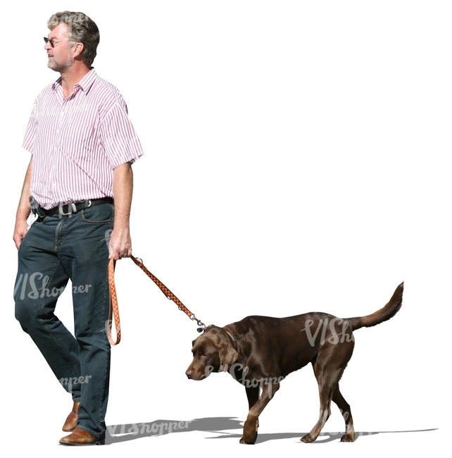 middle-aged man walking a dog