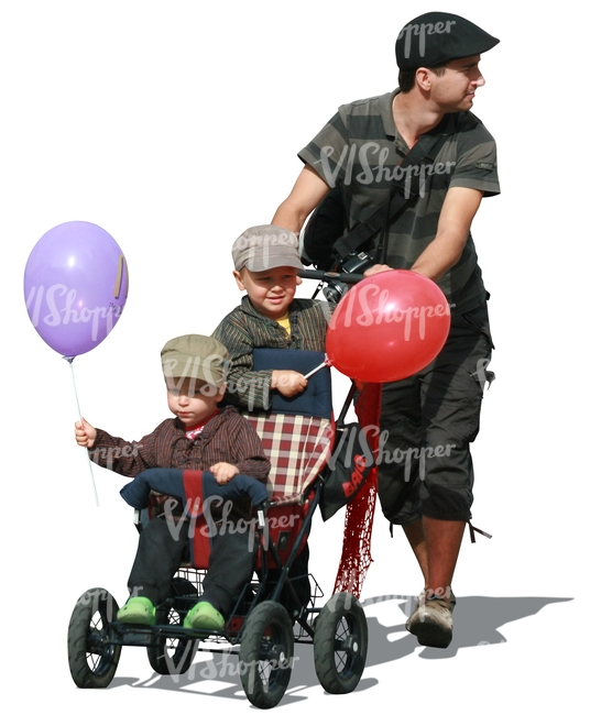 man pushing a baby stroller with two boys in it