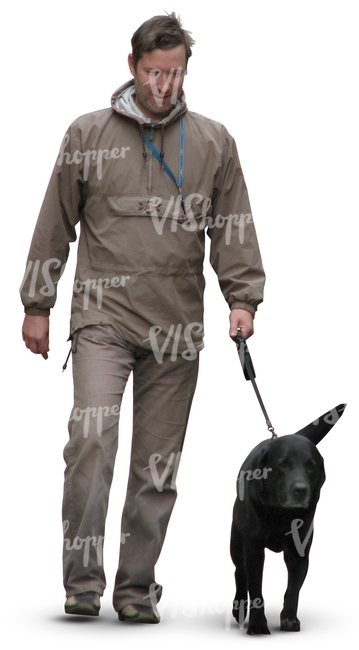 man walking a black dog