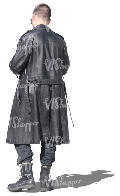 man in a black leather coat standing