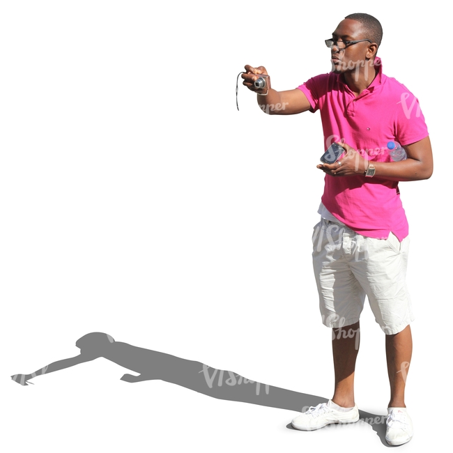 black man in shorts taking a picture