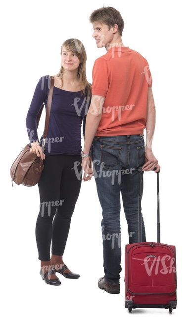 travelling couple standing with a suitcase