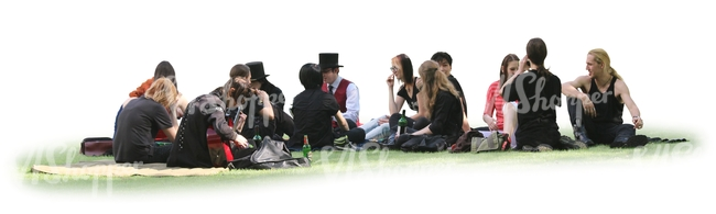large group of people sitting together on the grass